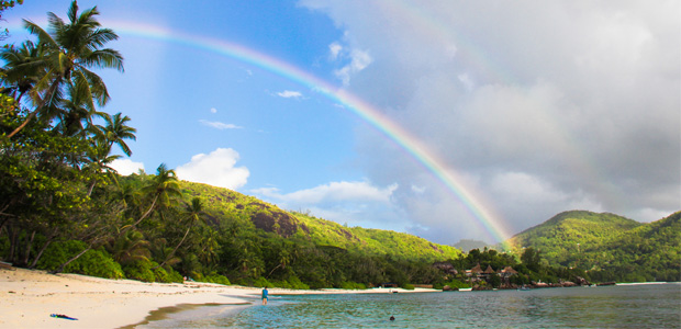 rainbow stretching above palm beach
