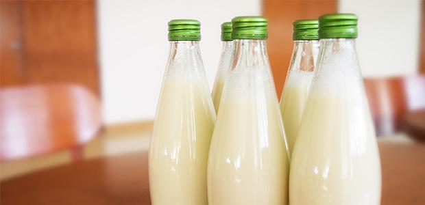 five glass bottles of milk